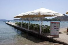 Waterfront Greek dining in Lefka Taverna, with tables set on the sand and along a small pier in very close to in the - Travel Memories, Greece Travel, Coastal, Greek, Patio, Vacation, Dining, Beach, Outdoor Decor