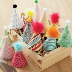 Birthday Hats made from whimsical cardstock and topped with pom poms and frilly marabou feathers. Set of 6 or 12