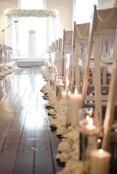 @Rachael Davies  This was what I was talking about. You could do floating candles, pillar ones in a vase or even the mason jars with the LED tea lights in them down the aisle.