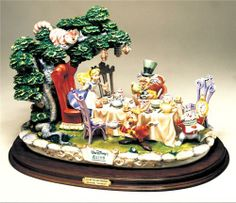 Disney Laurenz Capodimonte Alice Tea Party Figurine Reconditioned. This exquisite porcelain Capodimonte sculpture is from the Disney Laurenz Classic Collection. It is a limited edition of 322 pieces total made world wide. This is the Rolls Royce of Porcelains. This was created by Enzo Arzenton. This is truly a work of art. This piece measures 14 1/2 inches in height, 22 inches wide x 14 inches deep. Price $2,200 at ToysbyStacy.com