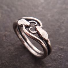 Double ouroboros snake ring in sterling silver (shiny finish) by Chuck Domitrovich of Down to the Wire Designs.