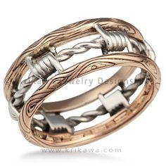 """Barbed Wire Wedding Band - Looking for a masculine, artisan wedding band? How about a gritty ring design reflective of your lifestyle or personality? Our Barbed Wire Wedding Band is the answer. The bars of this ring have a wood-grain pattern, with the """"wire"""" wrapped in-between."""