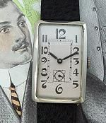 Men's late Art Nouveau; early Deco-era oversized tank-style wrist watch with hinged nickel case and exaggerated numerals; circa Teens.