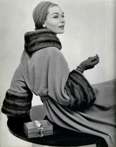 This robe coat from the 1950's with the fur cuffs and collar is so chic.