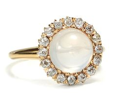 my wedding ring will look something like this. maybe not a giant pearl, and not gold but pearls will be incorporated