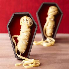 Wrap up a legion of scary mummies for an easy-to-make appetizer! Get more recipes here: http://www.bhg.com/halloween/recipes/halloween-recipe-ideas/?socsrc=bhgpin081814meatymummies&page=8