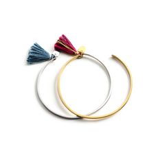 Each Tassel Cuff has a tassel woven with cotton and metallic fibers, and a dangling Buffalo Tooth Charm, representing a small piece of a greater whole. This piece is crafted in Sterling Silver or Gold Vermeil, and was handmade in Cambodia by a local artisan.