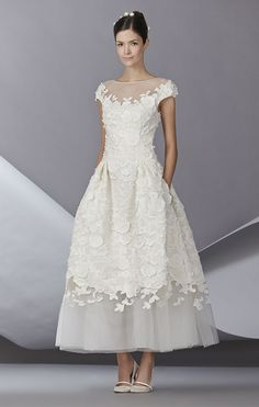 Unusual and fun ankle length dress with 3-D appliques and bonus pockets! By Carolina Herrera.