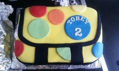 Mr Tumble spotty bag cake