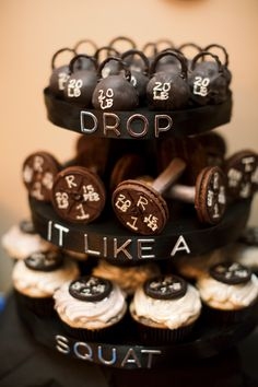 Oreo Ball Kettle Bells, Fudge Striped Barbells, and Plates Cupcakes for Work Out Themed First Birthday Party.