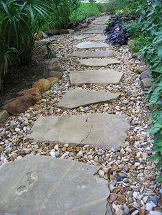 Austin lawn drainage, dry creek beds stepping stone pathway, back garden design, backyard Landscaping With Rocks, Front Yard Landscaping, Backyard Landscaping, Backyard Ideas, Stone Landscaping, Front Walkway, River Rock Landscaping, Patio Ideas, Modern Backyard