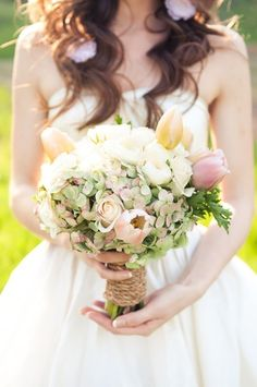 Hydrangea, Tulips, Roses... and a lovely nautical style rope in place of a ribbon. #wedding #bouquet #bride #pastels