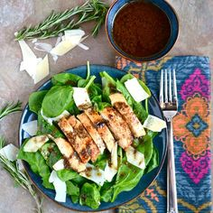 This simple and healthy spinach salad with chicken, parmesan cheese, and rosemary balsamic vinaigrette is packed full of flavor!
