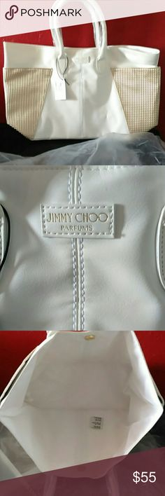 Jimmy choo parfums bag Beautiful bag, brand new. Is white and gold. I dont believe its aunthentic. But is very beautiful, and big. Gold part are extra compartments. Sorry no trades! Jimmy Choo Bags Totes