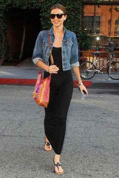 a casual long black dress and denim jacket