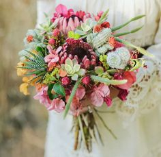 Bouquet by Primary Petals with succulents, king protea, bougainvillea + more!
