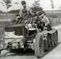 Soldiers riding in what could be a striped SdKfz 250 chassis