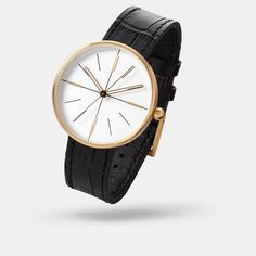 AÃRK Collective - Dome watch in gold/white. $199