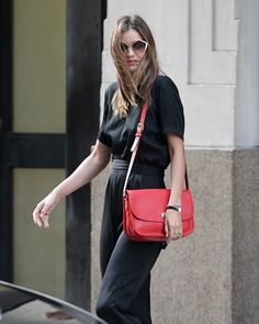 Miranda Kerr wearing the Coach Classic city Bag in bright red. Available at Metropolis at Metrotown