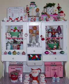 My antique white hutch full of vintage christmas fun!