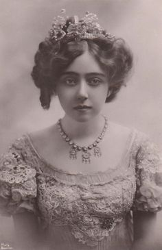 """May de Sousa (1884-1948) was an American singer and a Broadway actress. She came to fame in 1898 as the singer of """"Dear Midnight of Love"""", a ballad by Bathhouse John Coughlin. De Sousa retired in 1918, married a local doctor, and eventually moved to Shanghai. In 1943, following two periods as a prisoner of war in internment camps in China, she returned to the United States and took a job in Chicago as a scrubwoman in the public-school system. She died in Chicago charity ward of malnutrition."""
