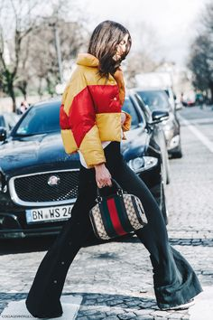 Street Style_ colour blocked puffa jacket worn with back with flared pants & statement bag | Saved by Gabby Fincham |