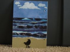 This is my favorite page. I found cloud stickers on clearance, the paper is from my stash and the beach is sandpaper. I colored the puffy bird with a marker.