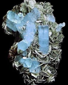 Beryl (Var: Aquamarine) with Muscovite | #Geology #GeologyPage #Mineral Locality: Nagar, Hunza Valley, Gilgit District, Gilgit-Baltistan, Pakistan SIze: 7 cm Photo Copyright © Kevin Ward Geology Page www.geologypage.com