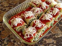 spinach and ricotta lasagna rolls--a faster take on lasagna, but definitely tasty! I used whole grain lasagna noodles for added fiber, and sauteed a bit of minced garlic and a chopped yellow bell pepper, wilted the spinach down, and mixed that in with the cheeses. The pepper and garlic give even more flavor. Really great!