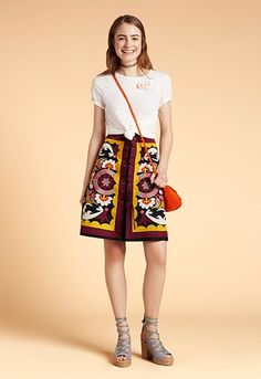 Model wearing ASOS folk embroidered skirt with white t-shirt