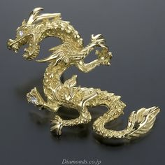 Gold and Diamond Dragon Brooch.