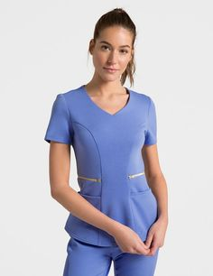 The Ponte Zipper Waist Top in Ceil Blue is a contemporary addition to women's medical scrub outfits. Shop Jaanuu for scrubs, lab coats and other medical apparel. Spa Uniform, Uniform Ideas, Navy Blue Uniform, Stylish Scrubs, Scrubs Outfit, Lab Coats, Medical Uniforms, Womens Scrubs, Medical Scrubs