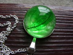 Necklace with green feather in resin by zusnA on Etsy