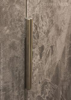 Joseph Giles CUBE Edge pulls on a velvert clad cabinet door
