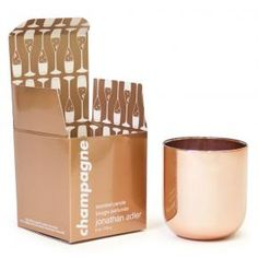 Jonathan Adler champagne candle in rose gold container. OBSESSED
