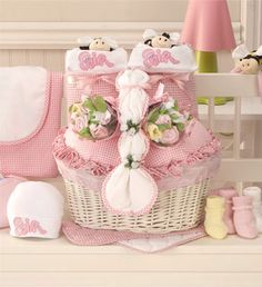 Baby girl gift basket pink pink gifts newborn baby girls and two sweet twin baby girls deserve a gift thats twice as nice this lined white wicker basket is filled with pretty in pink baby necessities times two negle Images
