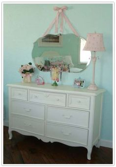 Hanging a mirror with ribbon - for the baby's room!