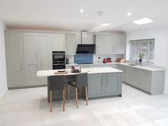 Our Conival in-frame Kitchen smooth painted in Elgin Grey with Opal Carrara Quartz worktops. www.saffroninteriors.co.uk 01483 511068 #kitchen #inframe #grey #white #blue #painted #glass #quartz #modern #traditional #classic