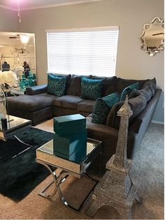Turquoise And Brown Living Room Decorating Ideas Display Cabinet Cozy Couch With Teal Accents Built In Home Decoration Allows You To Create Luxury Yet Modern Interior Design Projects Discover More Luxurious