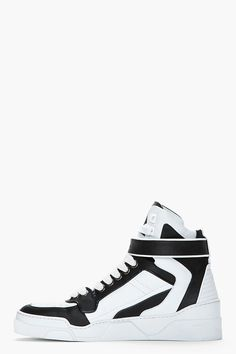 GIVENCHY //  Black & white leather high-top sneakers  31278M050008  High-top buffed leather sneakers in white and black. Round toe. White lace up closure with gold tone eyelets. Wrap-around Velcro strap at ankle. Ribbed panel at heel. Textured white rubber foxing. Tone on tone stitching. Leather upper, rubber sole. Made in Italy.  $645 CAD