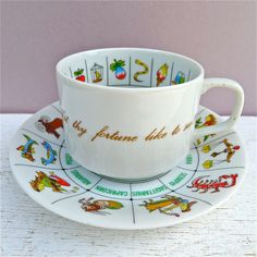 Divination:  A Zodiac teacup, for reading tea leaves.