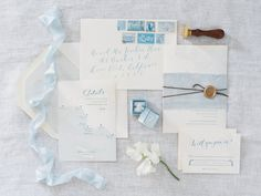 Stationery: Little Miss Press - http://www.stylemepretty.com/portfolio/little-miss-press Photography: The Grovers - www.troygrover.com   Read More on SMP: http://www.stylemepretty.com/2016/05/25/the-ultimate-something-blue-wedding-inspiration/