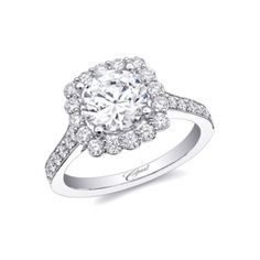 Coast Diamond Engagement ring (#LC10025) - A romantic design, this ring features a cushion-shaped halo of diamonds surrounding the center stone. Pave diamonds and milgrain edging decorate the shoulders of the ring.