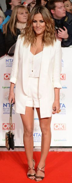 Caroline Flack in a mini white playsuit and matching blazer.