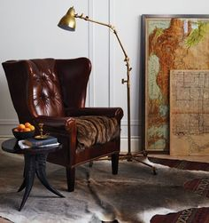 Library/Office/Craft Space: Leather chair, lamp, map