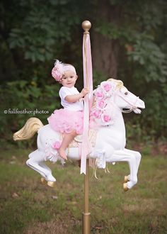 Vintage carousel horse birthday milestone session. Pink, white & gold theme. DIY carousel pony hand painted.   © Full Feather Photography  www.fullfeatherphotography.com  #CarouselTheme #BirthdaySession #VintageCakeSmash #MilestoneSession #BirthdayPhotos