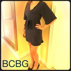 """NWT BCBG MaxAzria Mandy"""" dress Navy lightweight brushed silk BCBG MaxAzria """"Mandy"""" tie waist dress. V-neckline, belled short sleeves. Lightly ruched bodice, slightly longer in be back. Elasticized banded waist with tie closure. Curved pockets at waist. Measures approx 23 1/2"""" long from natural waist. 100% silk. BCBGMaxAzria Dresses"""