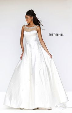 """Dress length: 45"""" (Waist to hem) Shown in: Ivory Share the pureness of heart with Sherri Hill 21269."""