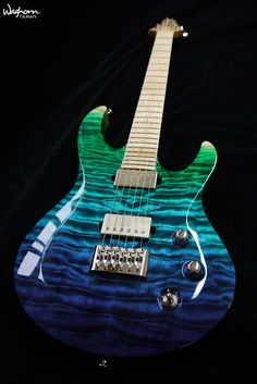 Custom neck-through Waghorn Kronos with quilted maple carved top in a gloss transparent blue/green/natural gradient finish. Seymour Duncan Custom Shop 'Greenie' pickups, chrome hardware by ETS and Gotoh.