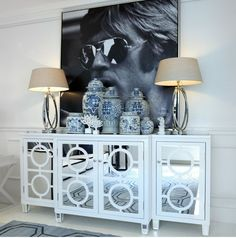 huge photo/credenza (skip all the pottery).